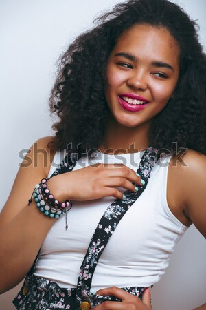 Stock photo: beauty young african american woman in bathrobe with tooth brush