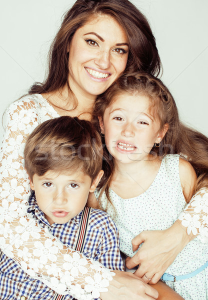 two pretty children kissing their mother happy smiling close up, happy family, brother and sister, l Stock photo © iordani