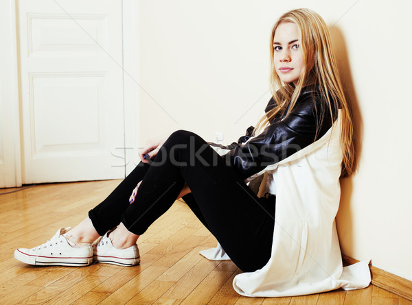 young pretty teenage blond girl sitting on floor at home despair Stock photo © iordani