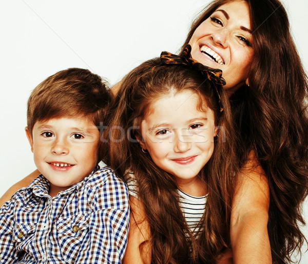 Dos bastante ninos besar madre feliz Foto stock © iordani