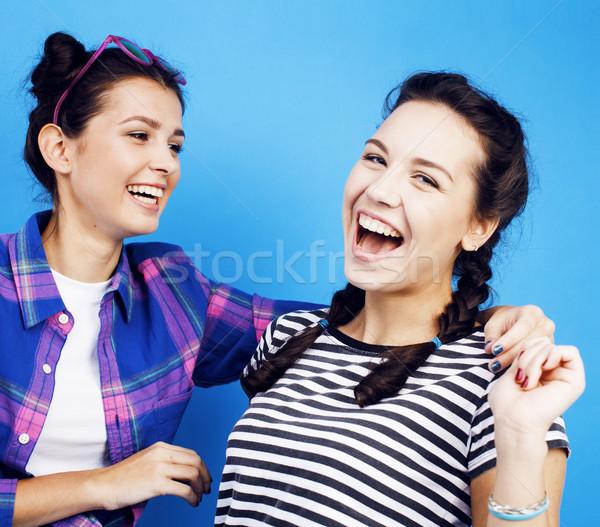 best friends teenage school girls together having fun, posing emotional on blue background, besties  Stock photo © iordani