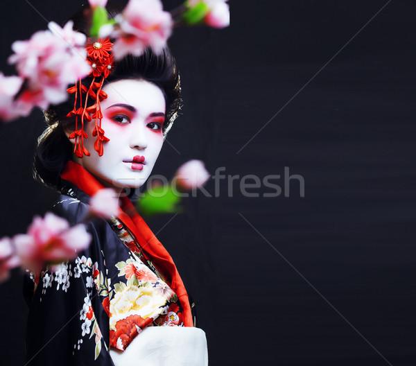 Genç güzel geyşa kimono sakura dekorasyon Stok fotoğraf © iordani