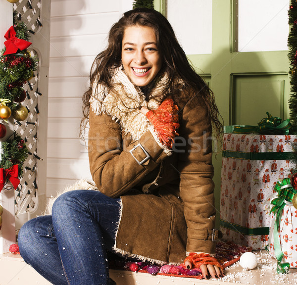 happy young girl at home decorated on Christmas, bringing gifts to friends Stock photo © iordani