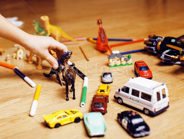 children playing toys on floor at home, little hand in mess, free education Stock photo © iordani