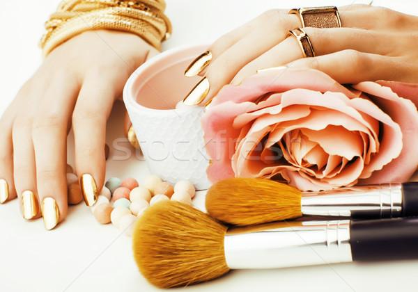 Kadın eller altın manikür çok halkalar Stok fotoğraf © iordani