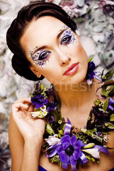 floral face art with anemone in jewelry, sensual young brunette  Stock photo © iordani
