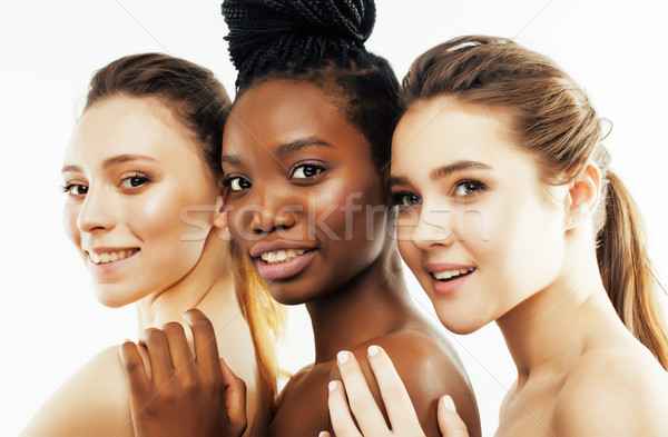 three different nation woman: african-american, caucasian together isolated on white background happ Stock photo © iordani
