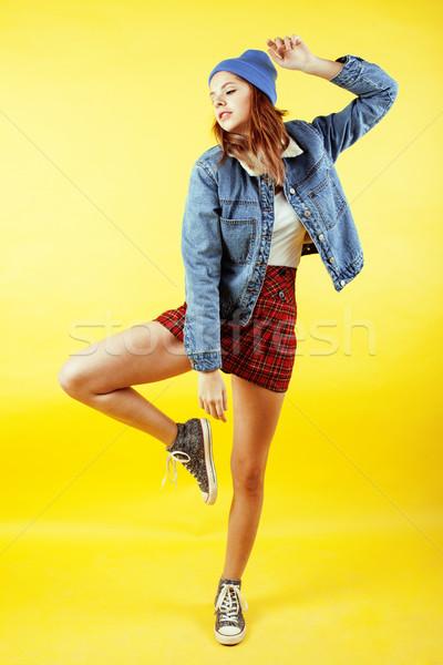 Genç güzel genç kız poz sarı Stok fotoğraf © iordani