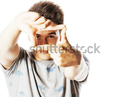 young pretty man framing with fingers isolated on white Stock photo © iordani