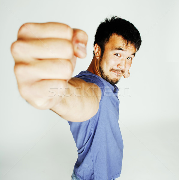 Stock photo: young cute asian man on white background gesturing emotional, po