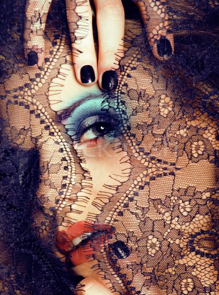portrait of beauty young woman through lace close up mistery makeup, stylish fashion lady Stock photo © iordani