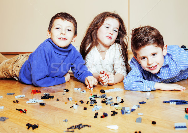 funny cute children playing toys at home, boys and girl smiling, first education role close up, life Stock photo © iordani