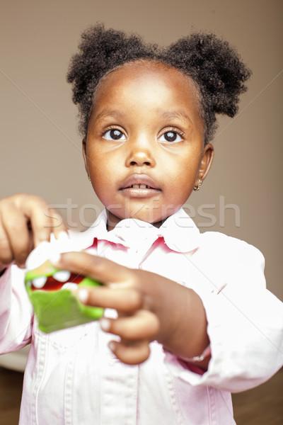 Küçük sevimli kız oynama hayvan Stok fotoğraf © iordani
