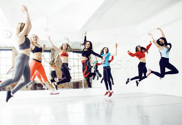 Women doing sport in gym, jumping, healthcare lifestyle people concept, modern loft studio  Stock photo © iordani