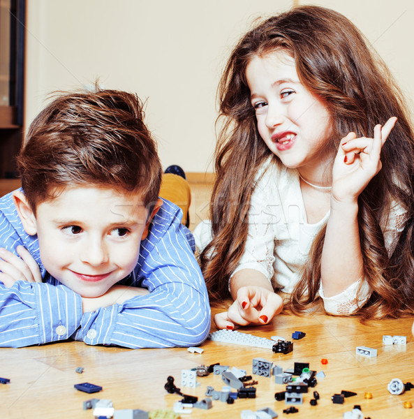 funny cute children playing lego at home, boys and girl smiling, first education role lifestyle clos Stock photo © iordani
