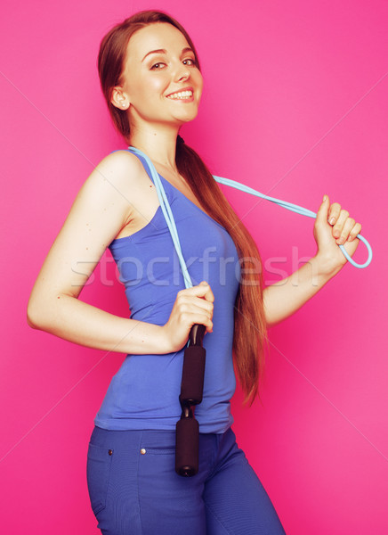 young happy slim girl with skipping rope on pink background smil Stock photo © iordani