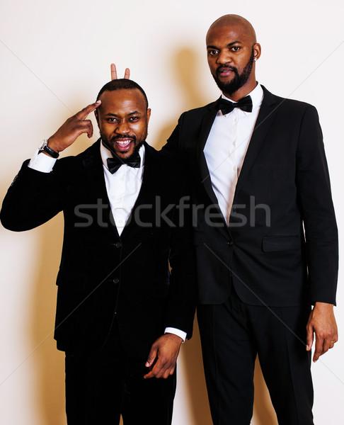 Kettő üzletemberek fekete öltönyök érzelmes pózol Stock fotó © iordani