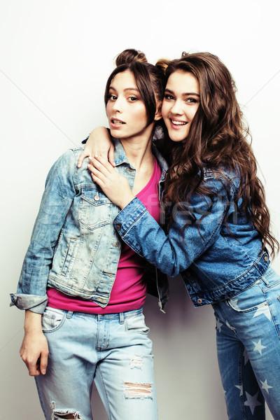 best friends teenage girls together having fun, posing emotional on white background, besties happy  Stock photo © iordani