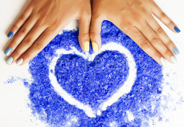 manicure with blue nails and seasalt close up like heart, love f Stock photo © iordani