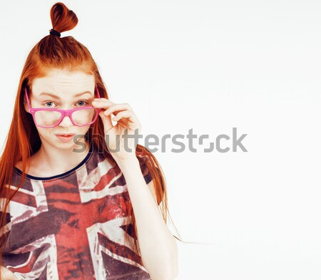 young pretty red head teenage hipster girl posing emotional happy smiling on white background, lifes Stock photo © iordani