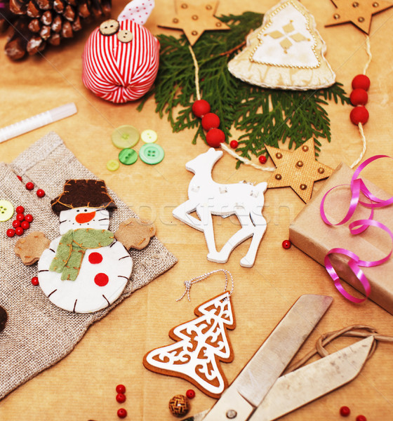 lot of stuff for handmade gifts, scissors, ribbon, paper with countryside pattern, ready for holiday Stock photo © iordani
