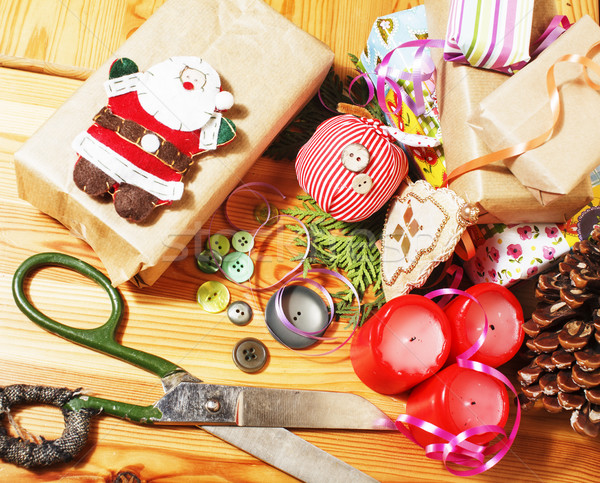 handmade christmas gifts in mess with toys, candles, fir, ribbon wooden vintage Stock photo © iordani