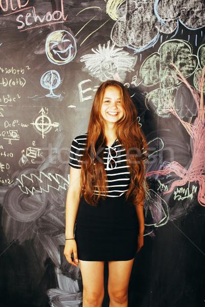 portrait of happy cute student in classroom at blackboard back to school having fun, girl at college Stock photo © iordani