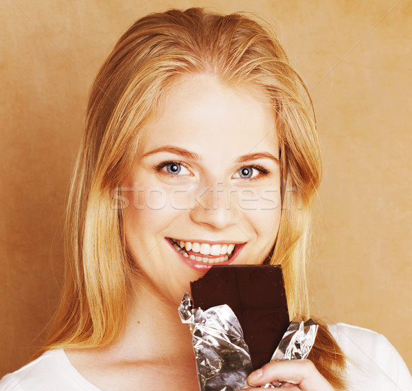 young cute blond girl eating chocolate and drinking coffee close Stock photo © iordani