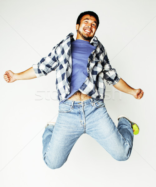young pretty asian man jumping cheerful against white background Stock photo © iordani
