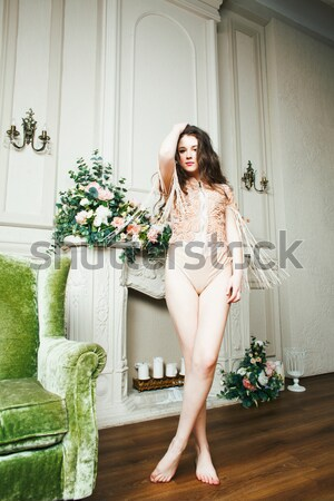 young pretty brunette girl in fashion dress on sofa posing in luxury rich home interior, lifestyle m Stock photo © iordani