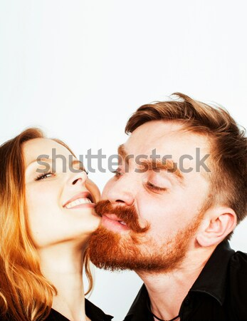 young hipster couple fooling around on white background close up Stock photo © iordani