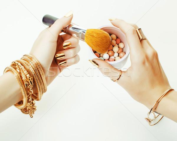 Nő kezek arany manikűr sok gyűrűk Stock fotó © iordani