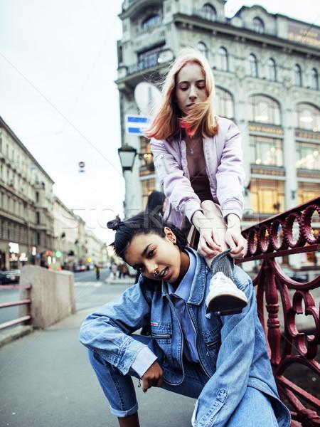 cute young couple of teenagers girlfriends having fun, traveling europe, modern fashion citylife, li Stock photo © iordani