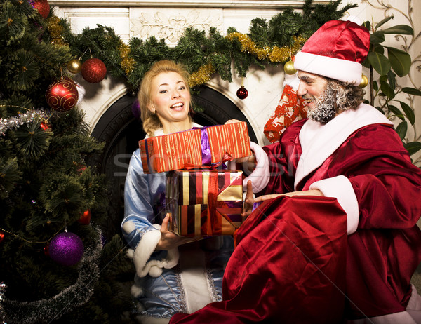 portrait of Santa Claus with Snow Maiden at Cristmas tree holdin Stock photo © iordani