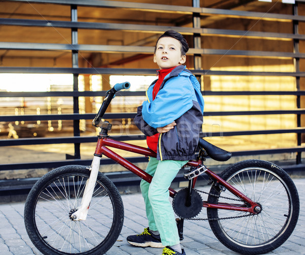 young kid on cool bmx bicycle riding outside, lifestyle people c Stock photo © iordani