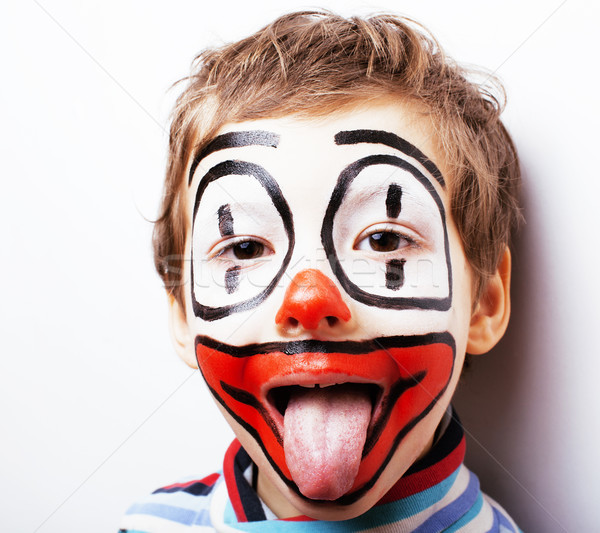 little cute boy with facepaint like clown, pantomimic expression Stock photo © iordani