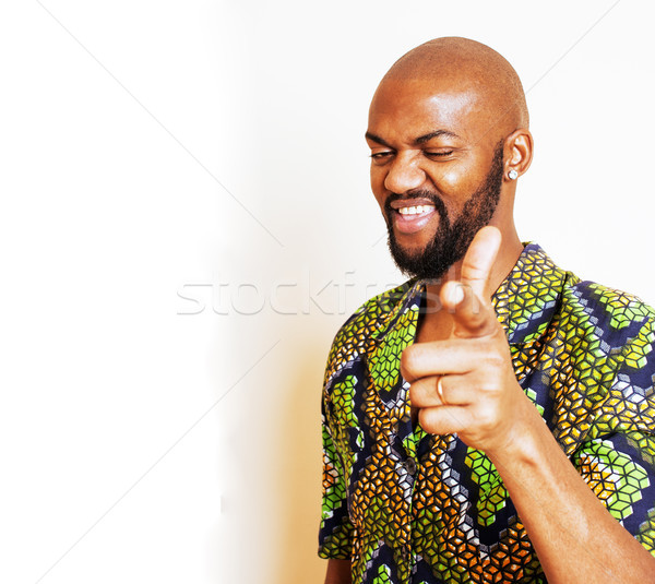 Stock photo: portrait of young handsome african man wearing bright green nati