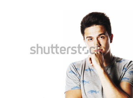 young attractive man isolated thinking emotional on white close  Stock photo © iordani