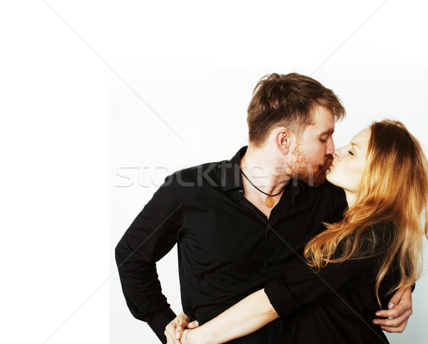 young hipster couple fooling around on white background Stock photo © iordani