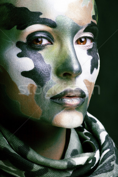 Beautiful young fashion woman with military style clothing and face paint make-up, khaki colors, hal Stock photo © iordani