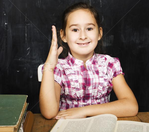 cute little real girl pupil in classroom at blackboard writting, girl school, ready to answer Stock photo © iordani