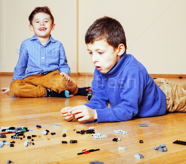 funny cute children playing at home, boys and girl smiling, first education role lifestyle Stock photo © iordani