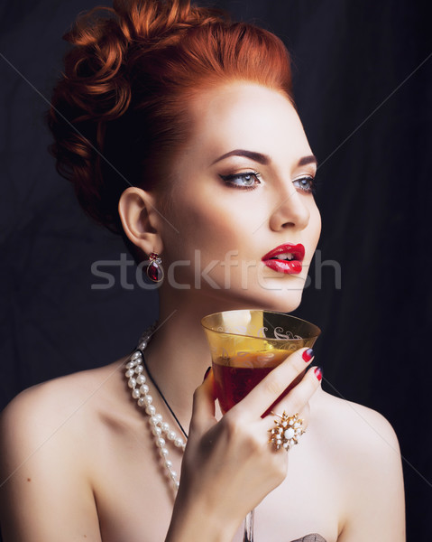 beauty stylish redhead woman with hairstyle and manicure wearing Stock photo © iordani