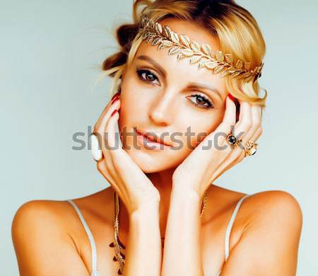 young blond woman dressed like ancient greek godess, gold jewelry close up isolated, summer trends Stock photo © iordani