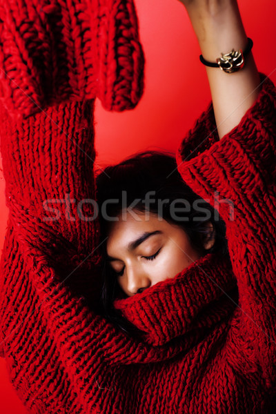 young pretty indian mulatto girl in red sweater posing emotional, fashion hipster teenage, lifestyle Stock photo © iordani
