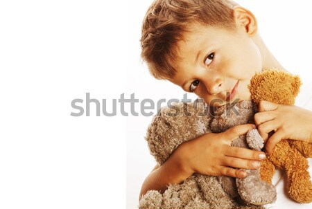 Stock photo: little cute boy with many teddy bears hugging isolated close up