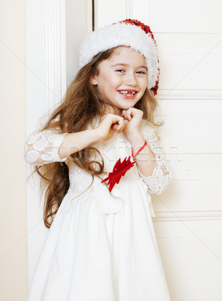 little cute girl in santas red hat waiting for Christmas gifts. smiling adorable kid. White new dres Stock photo © iordani