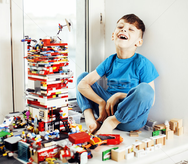 little cute preschooler boy playing toys at home happy smiling,  Stock photo © iordani