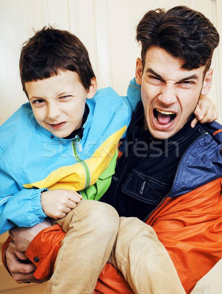 young handsome hipster father with his son fooling around at hom Stock photo © iordani