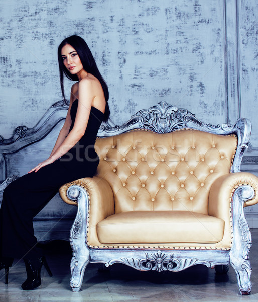 beauty young brunette woman in luxury home interior, fairy bedroom in grades of grey Stock photo © iordani